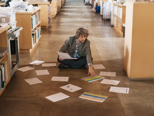 Man organizing documents in library --- Image by © Hiya Images/Corbis